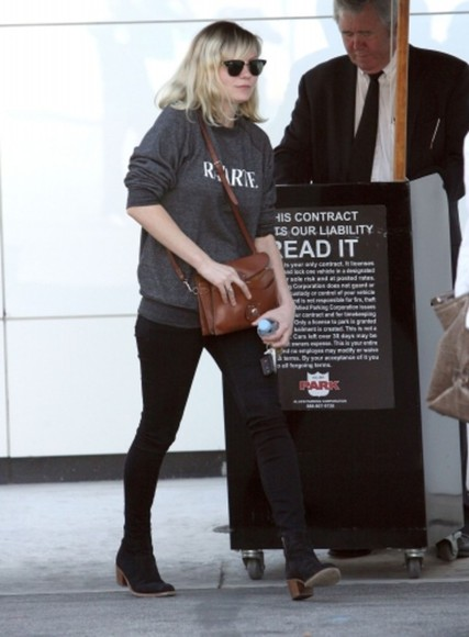kirsten dunst black shoes grey sweater