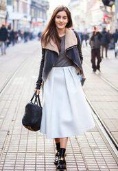 skirt,winter leather jacket,grey t-shirt,white pleated skirt,black bag,black boots,blogger