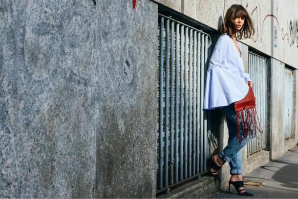 a portable package blogger top jeans light blue flare black heels fringed bag