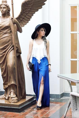 brown platform blogger slit skirt blue skirt white top hat pouch slit pants blue pants black hat summer outfits