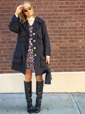 man repeller blogger parka black boots floral dress