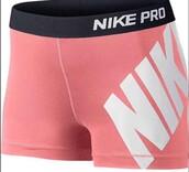 shorts,nike,short nike pros,nike shorts,spandex,pink,white,elasticated waistband