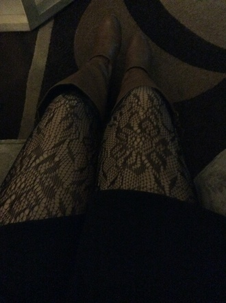 tights black fish nets w skater skirt & brown boots .