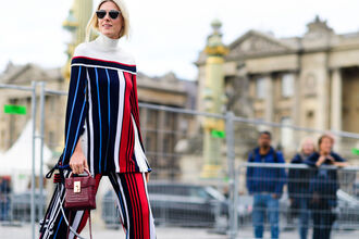 top fashion week street style fashion week 2016 fashion week paris fashion week 2016 stripes striped top striped pants pants wide-leg pants off the shoulder off the shoulder top white top turtleneck bag red bag burgundy bag burgundy sunglasses streetstyle