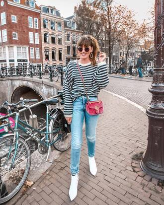 sweater tumblr cozy cozy sweater stripes striped sweater denim jeans light blue jeans boots white boots bag crossbody bag sunglasses
