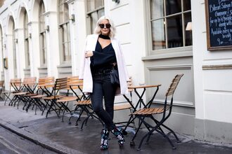 the courtney kerr blogger coat sweater shoes jeans bag sunglasses jewels white coat black blouse black jeans ankle boots printed boots black bag