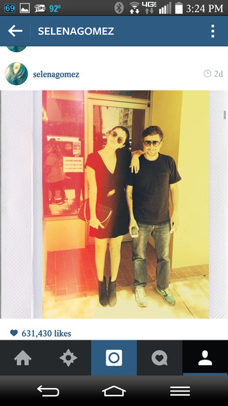 little black dress boots sunglasses purse nail polish gomez selena