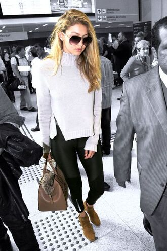 leggings gigi hadid gigi hadid leggings gigi hadid style celebrity style celebrity airport fashion sweater grey sweater bag brown bag handbag sunglasses aviator sunglasses model ankle boots suede boots