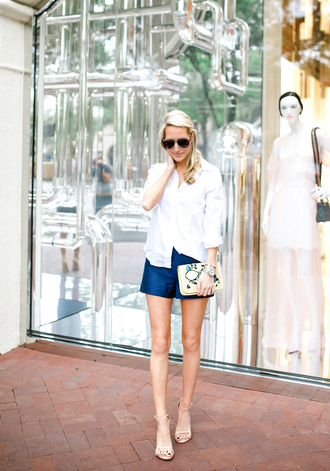 krystal schlegel blogger blouse sunglasses blue shorts white blouse button up long sleeves white top clutch nude heels sandal heels summer outfits