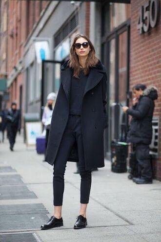 shoes long black coat black sweater black pants oxfords blogger sunglasses
