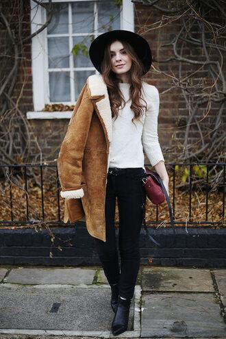 coat black hat brown suede coat white sweater black jeans black boots blogger