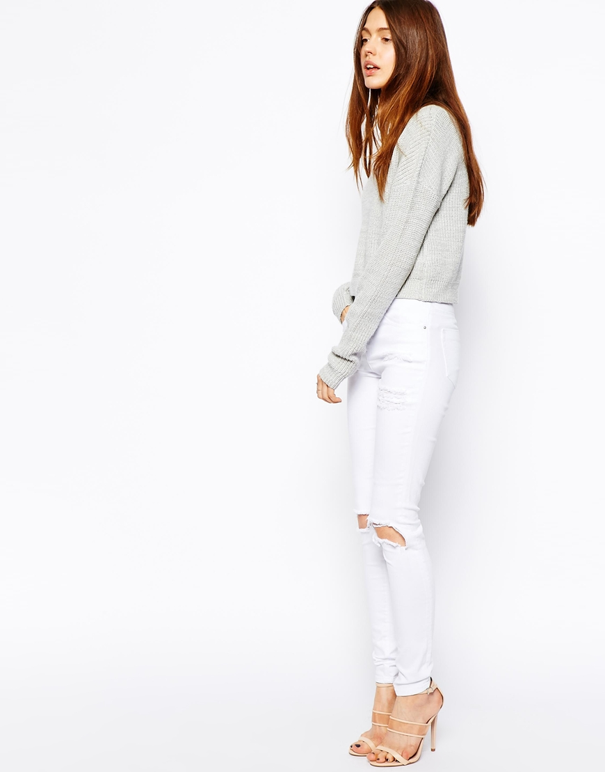 ASOS Ridley Skinny Jeans in White with Thigh Rip And Busted Knees at asos.com