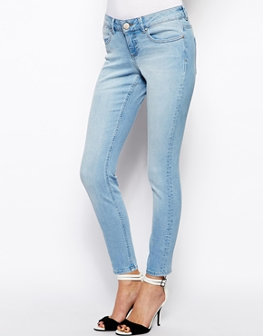 ASOS | ASOS Whitby Low Rise Skinny Ankle Grazer Jeans in Watercolour Light Wash Blue at ASOS