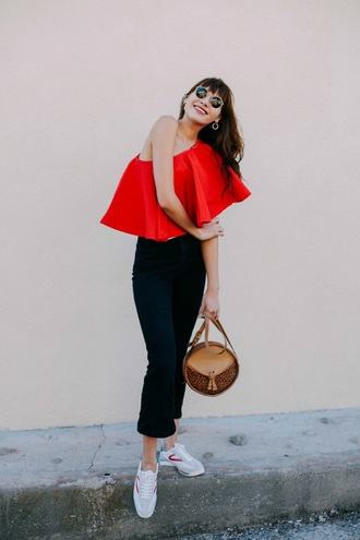 natalie off duty blogger bag off the shoulder red top one shoulder black jeans white sneakers jeans asymmetrical top date outfit shoulder bag le fashion image skinny jeans high waisted jeans ruffle ruffled top