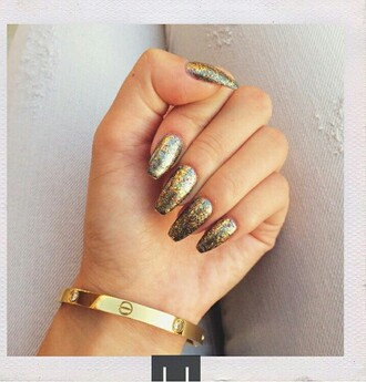 nail polish nails gold cosmetics gold nails bling sparkle glitter jewels jewelry bracelets gold bracelet metallic nails