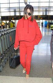 pants,red,selena gomez,sweatshirt,hoodie,sweatpants,sandals,sweater