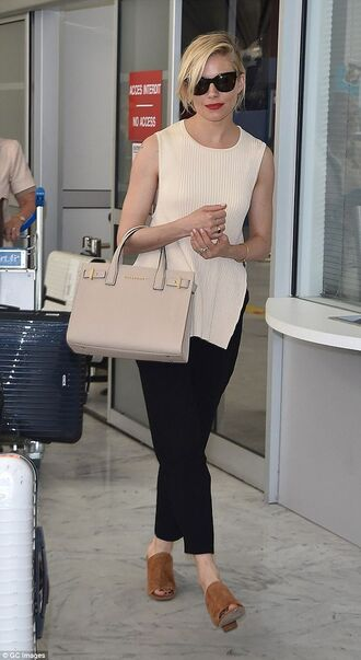 shoes suede mule mules brown shoes pants black pants top nude top slit top bag nude bag sunglasses black sunglasses sienna miller celebrity celebrity style airport fashion
