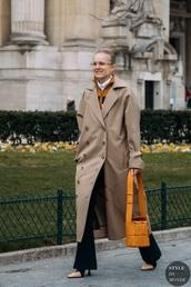 coat,camel coat,black pants,flare pants,glasses,bag,trench coat,long coat,pants