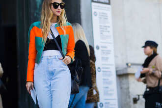 jacket fashion week street style fashion week 2016 fashion week paris fashion week 2016 cropped jacket orange top black top black crop top crop tops t-shirt white t-shirt denim jeans blue jeans sunglasses black sunglasses streetstyle queen of jet lags blogger