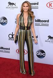 jumpsuit,sequin jumpsuit,sequins,stripes,v neck,plunge v neck,waist belt,belt,clutch,chrissy teigen,celebrity style,celebrity,model,party outfits