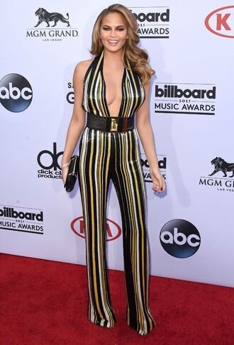 jumpsuit sequin jumpsuit sequins stripes v neck plunge v neck waist belt belt clutch chrissy teigen celebrity style celebrity model party outfits