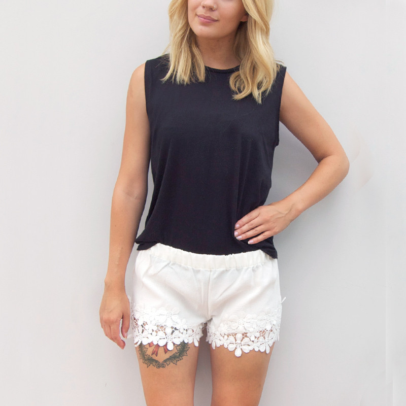 Shorts with large lace hem in white by little by little