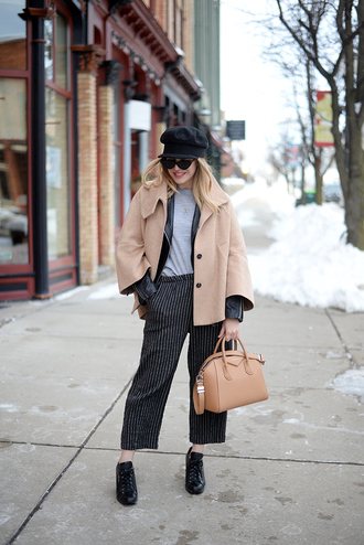blonde bedhead blogger pants shoes bag hat sweater jewels jacket sunglasses fisherman cap handbag striped pants black leather jacket winter outfits