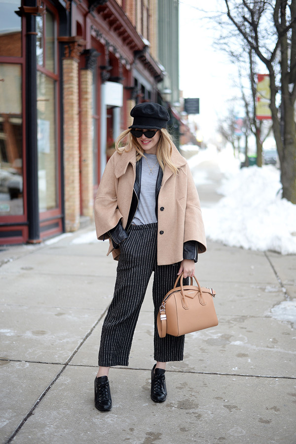 blonde bedhead blogger pants shoes bag hat sweater jewels jacket sunglasses fisherman cap handbag striped pants black leather jacket winter outfits