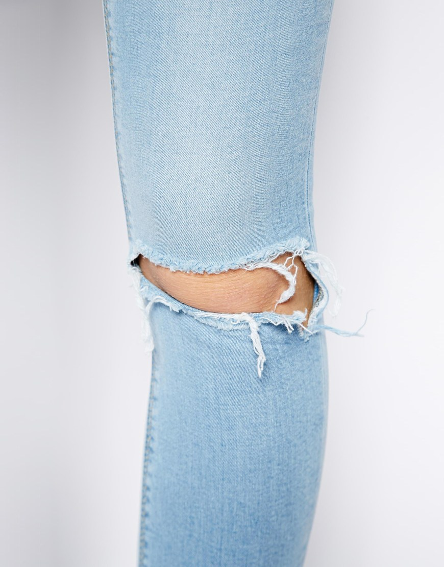 Asos ridley high waist ultra skinny jeans in watercolour light wash blue with busted knees at asos.com