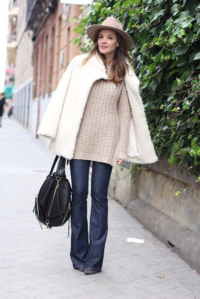 lady addict blogger fuzzy coat fedora oversized sweater knitted sweater white coat leather backpack coat jeans sweater hat white fluffy coat flare jeans blue jeans denim winter outfits winter look winter coat teddy bear coat