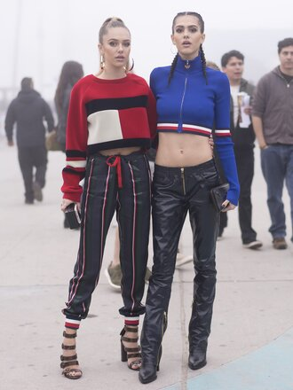 top tumblr streetstyle fashion week 2017 fashion week tommy hilfiger crop top tommy hilfiger pants black pants leather pants black leather pants boots black boots crop tops blue top cropped hoodie red top printed pants sandals sandal heels high heel sandals 00s style