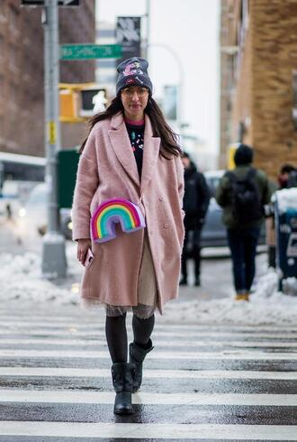 bag nyfw 2017 fashion week 2017 fashion week streetstyle pink coat oversized oversized coat skirt midi skirt nude skirt sweater black sweater tights opaque tights boots black boots grey beanie beanie printed bag