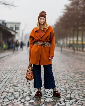 coat tumblr orange orange coat oversized oversized coat sweater cable knit belt denim jeans blue jeans cropped jeans denim culottes culottes shoes red shoes furry shoes bag beanie sunglasses clear lens sunglasses streetstyle fashion week 2017