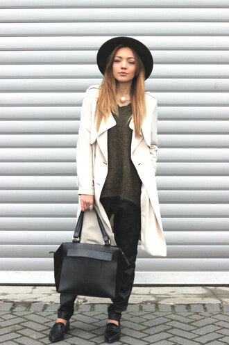 hat black hat green sweater white coat black trousers black mules