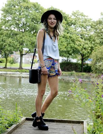 laughing in the purple rain blogger hat tribal pattern white tank top black bag