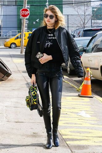 jacket gigi hadid bomber jacket bomber jacket black bomber jacket gigi hadid celebrity style celebrity model off-duty black leather pants leather pants ankle boots black boots boots sunglasses black sunglasses backpack printed backpack black pants