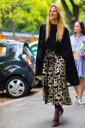 skirt,fashion week street style,fashion week 2016,fashion week,milan fashion week 2016,printed skirt,midi skirt,top,black top,long sleeves,boots,burgundy,purple,bag,black bag,fall outfits,streetstyle