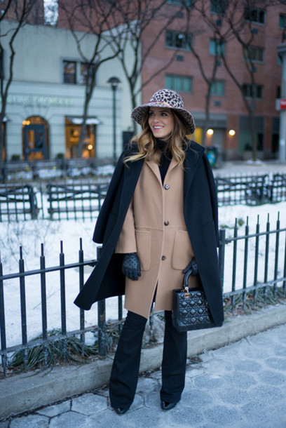 gal meets glam blogger gloves hat winter coat camel coat handbag flare jeans