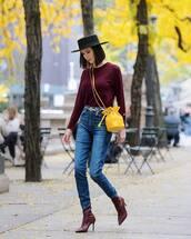 bag,crossbody bag,mini bag,jeans,high waisted jeans,sock boots,snake print,blouse,belt,hat