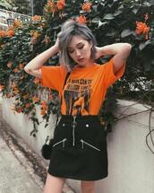 t-shirt,black skirt,tumblr,orange,orange top,skirt,mini skirt,zipped skirt,hair,platinum hair,short hair,earrings,silver earrings