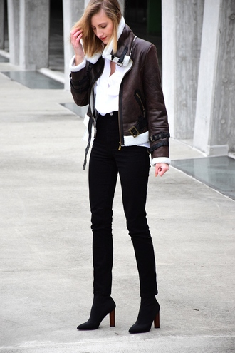 katiquette blogger jacket jeans shirt shoes brown jacket black pants high waisted pants ankle boots tumblr shearling jacket brown shearling jacket shearling white shirt fall outfits black jeans skinny jeans boots black boots high heels boots sock boots