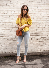 twenties girl style,blogger,top,shoes,jewels,sunglasses,bag,tank top,jacket,jeans,yellow top,off the shoulder top,shoulder bag,sandals,skinny jeans,spring outfits