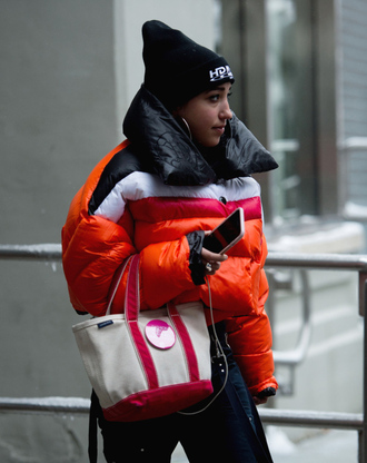 jacket bag tumblr nyfw 2017 fashion week 2017 fashion week streetstyle puffer jacket orange down jacket quilted beanie black beanie earrings jewels jewelry winter outfits winter jacket winter look