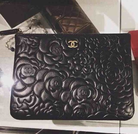 chanel bag embossed details clutch bag floral black leather fiftyfootfashionista
