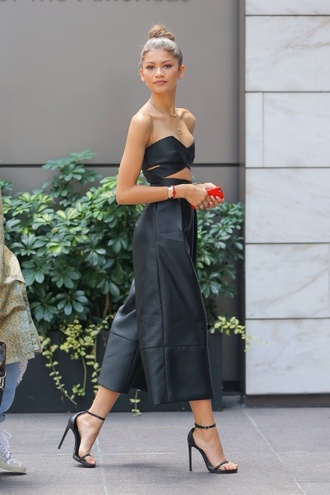top pants shoes wide leg jumpsuit barely there heels zendaya black jumpsuit strapless jumpsuit black barely there heels jumpsuit cut-out cropped jumpsuit sandals sandal heels high heel sandals black sandals leather sandals all black everything celebrity style celebrity