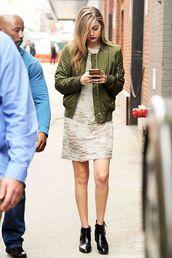jacket,gigi hadid bomber jacket,bomber jacket,satin bomber,green bomber jacket,green jacket,dress,boots,ankle boots,black boots,gigi hadid,gigi hadid style,celebrity,celebrity style,streetstyle,model off-duty,white dress,mini dress