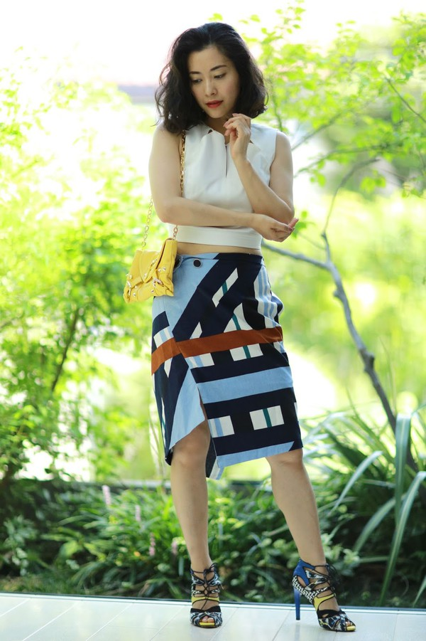 fetish tokyo blogger bag shoes white top shoulder bag yellow bag stilettos lace up heels crop tops multicolor printed  skirt sandals high heel sandals sandal heels blue sandals crop tops white crop tops asymmetrical asymmetrical skirt summer outfits summer top printed sandals