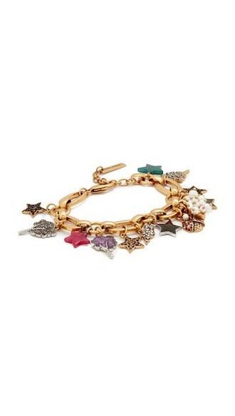 statement charm bracelet gold jewels