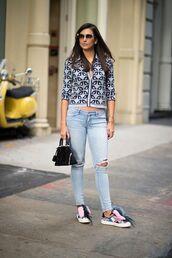 jeans,blue print shirt,distressed denim jeans,colorful sneakers,black handbag,blogger,sunglasses