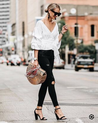 top tumblr white top v neck wrap top denim jeans black jeans ripped jeans skinny jeans sandals sandal heels black sandals bag sunglasses earrings pompon earrings jewels shoes